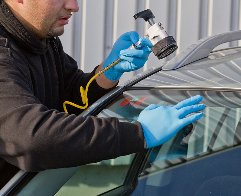Service agent repairs damaged windshield on location without replacement glass for free, Smart repair