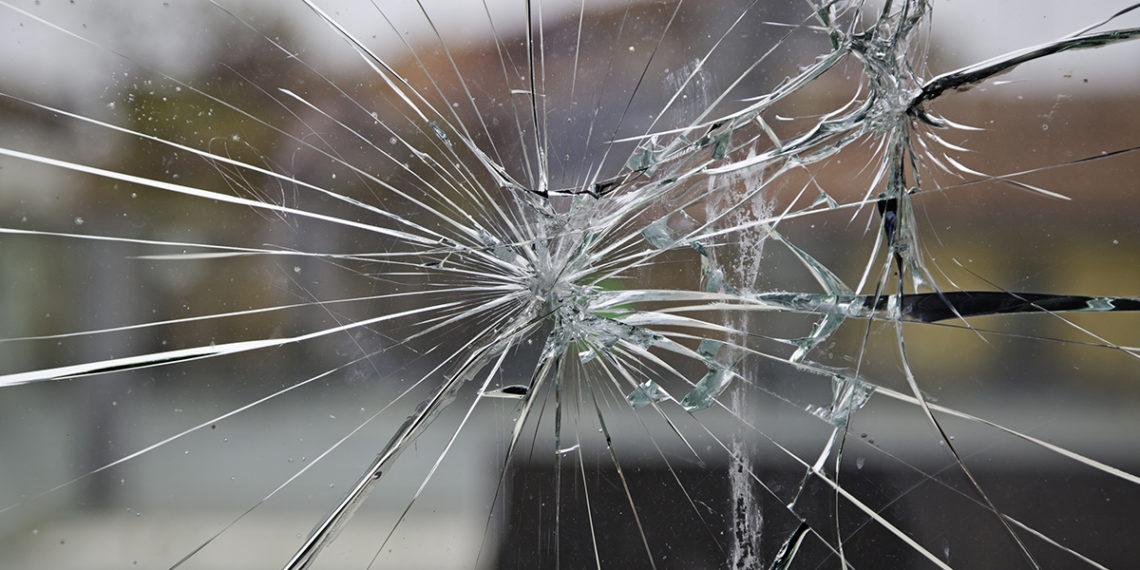 Broken glass, broken glass detail by a blow, vandalism
