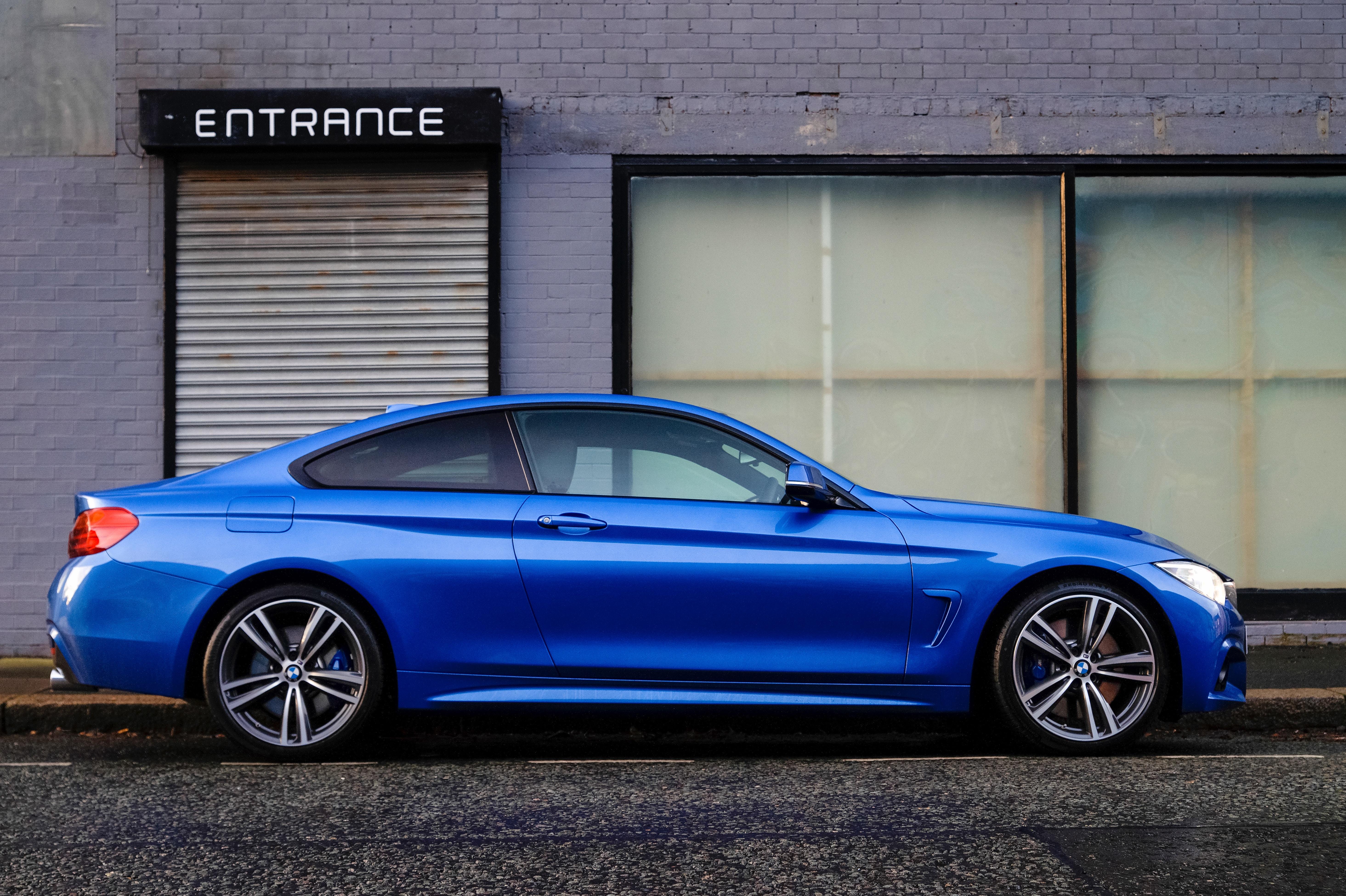 blue car next to a business