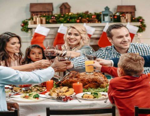 diverse family members toasting at holiday dinner