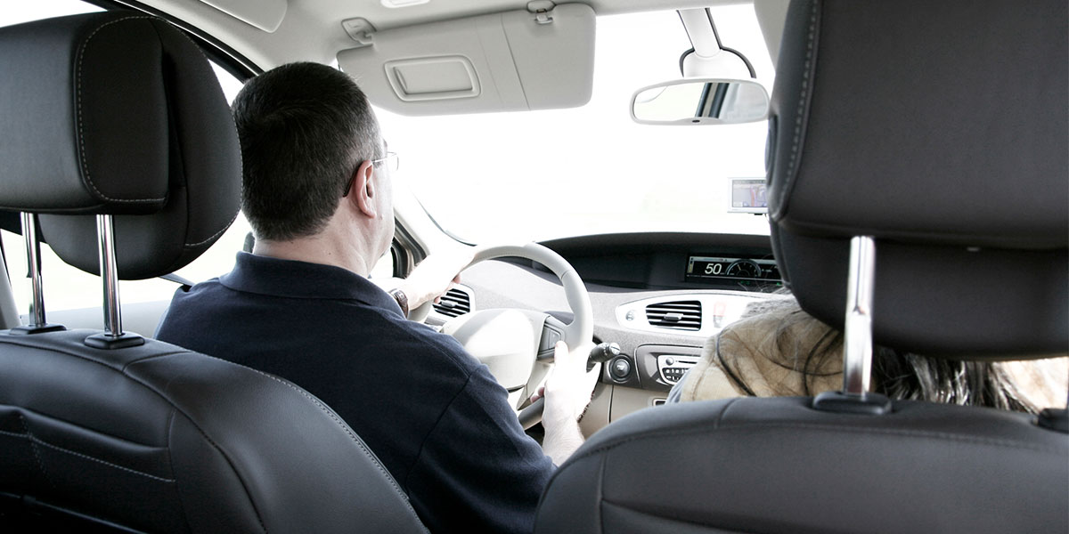 interior view of car, seats, and headrests with man and woman