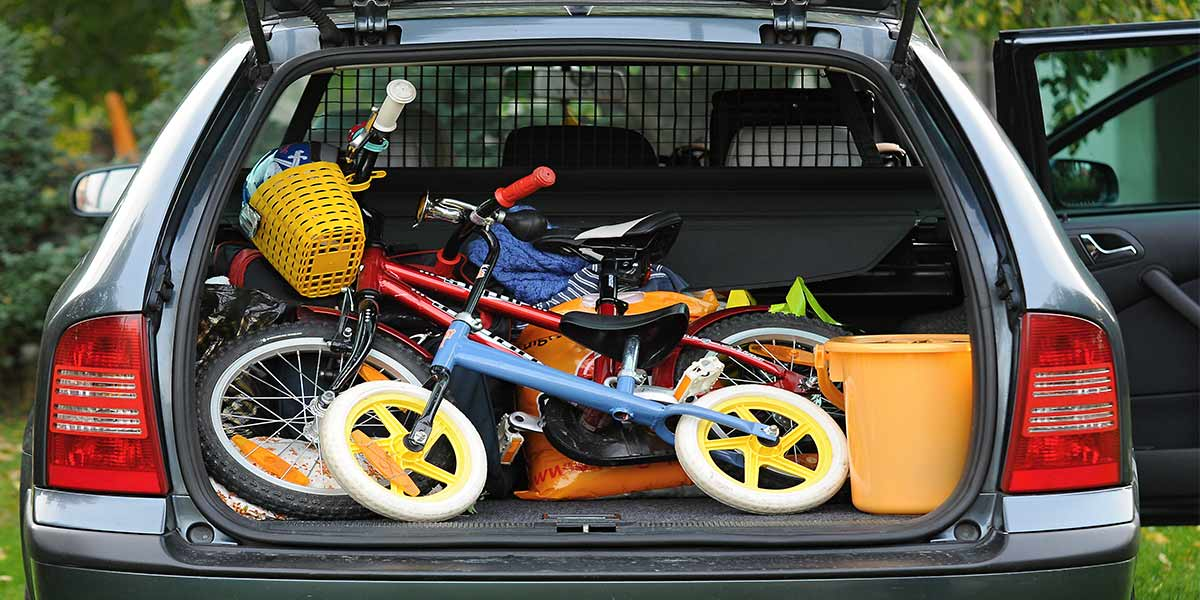 hatchback trunk with children's bicycles and storage bins