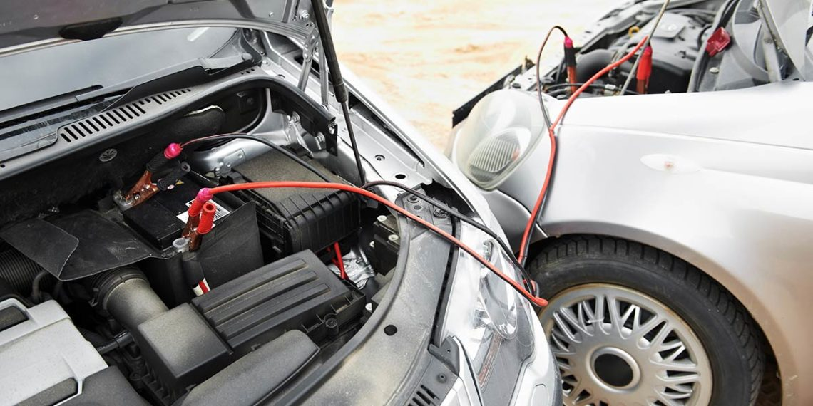 Jumper cables and a car being jumped