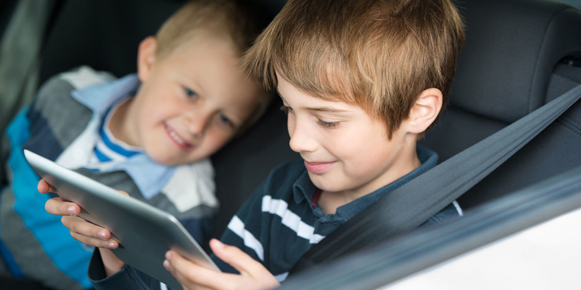 Kids playing games in a car