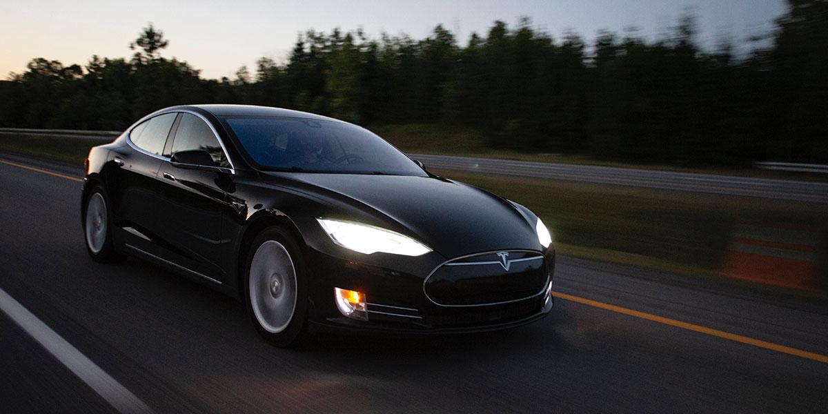 Tesla driving at dusk