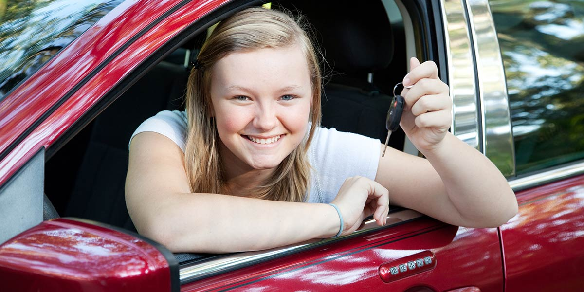 teen driver with first car